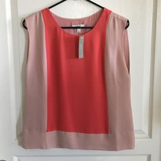 NWT J Crew Color Block Top Size 2 NWT. Size 2. Loose fitting, sleeveless blouse with color blocking in front and back. Colors are dusty pink and coral. Material is 100% silk. There is a tiny spot on chest that is barely noticeable. See last picture. No trades or Paypal. J. Crew Tops Blouses