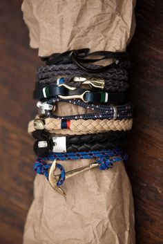 Miansai men's bracelet - Between the thick leather rope styles, the anchor hooks, the woven leather wraps or the nautical fish hooks, there's something for everyone, via https://www.shopacrimony.com/designers/miansai