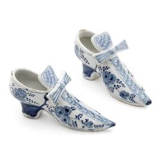 Two dutch delft shoes, with bows, early 18th century.