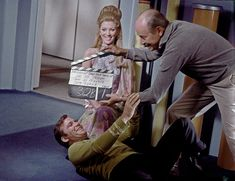 Kathie Browne as Deela the Scalosian and William Shatner have some fun during the clapperboard set up in what started as a blooper potential moment for this scene from the third season episode Wink of an Eye.