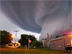 This photograph of a tornado was taken when Lori Mehmen looked outside her front door in Iowa. Spectacular and humbling.