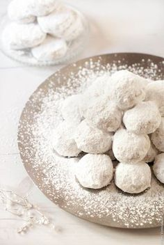 Kourabiedes are traditional Greek cookies made for Christmas. A type of buttery melt-in-your-mouth shortbread dotted with almonds and absolutely smothered in icing sugar. You can't not like them.
