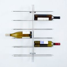 West Elm - Universal Expert 12 Bottle Wine Rack $70  I saw you had some wine on the floor, and I thought it might be nice to display on a wall in the dining area?  Unfortunately, most involve wood, but this one is chrome/nickel.  It's just not as attractive as some.