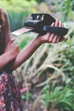 taking polaroid pictures
