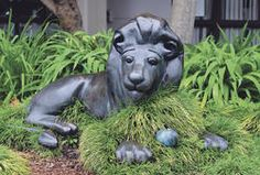 The Lion in the Meadow statue, Whakatane.  This statue was outside the public library until it moved to a new building and the hope is that the statue will be relocated to again be back near the books.  Margaret Mahy (1936 - 2012) was born and grew up in Whakatane.  Great public art. Margaret Mahy, Lion Images, Image Theme, Kiwiana, Public Art, Statues, New Zealand, Authors, Storytelling