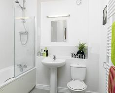 Contemporary white sanitaryware with chrome mixer taps all with power shower