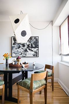 See designer Zak Profera designing a gorgeous one-bedroom apartment. The founder of ZAK and FOX decorates his Tribeca pad in an internationally inspired setting for his cultivated fabric collection. For more home tours go to Domino.