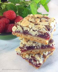 Raspberry Peach Almond Shortbread Bars: simple to make and uses all the goodies: butter, flour, sugar, jam, almonds. You are gonna love these Raspberry Peach Shortbread bars. allie @ Through Her Looking Glass Pinned Just Desserts, Delicious Desserts, Yummy Food, Cake Bars, Dessert Bars, Yummy Treats, Sweet Treats, Blueberry Pound Cake, Cookie Recipes