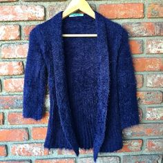 "Fuzzy cardigan Navy, open, fuzzy cardigan with draped front. Nwot. Measurement: bust - 13"", sleeves- 17"", length- 24"", hem- 19"". Sweaters Cardigans"