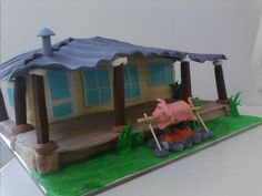 Fondant Pig on a spit and cabin cake!!
