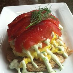 Kalapawai in Kailua Hawaii  House-cured , wild caught Alaskan Main Bay sockeye salmon served over two eggs scrambled with melted havarti cheese and hauula tomatoes on toasted rye. Topped with a lemon and nalo herbed creme fraiche