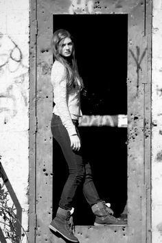 This is me at an abandoned building by the train tracks and I insisted that Kelly take the picture in black and white and I was sure right!