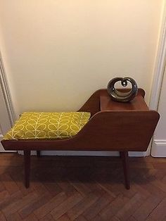 Vintage telephone table with Orla Kiely seat cushion