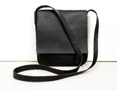 """A small, minimal crossbody bag. Made of black genuine high quality leather. With one pockets inside. No lining. Dimesions: height: 23 cm/ 9"""" witdht: 20 cm/ 8,2"""" depth: 4 cm/ 1,5"""" adjustable..."""