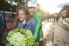 Peter Sagan gives his girlfriend Katarina Smolkova a ride on his bike following the last day of the 2015 Tour de France.