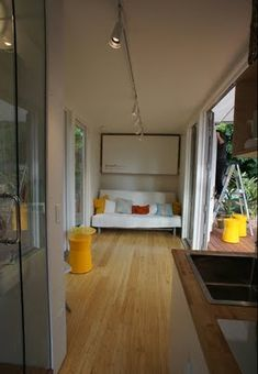 Shipping container house (sunset cargotecture) | Love the beautiful flooring. If you click through, you can see the yellow outside walls.