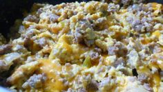 Cheesy Scrambled Eggs with Sausage and Caramelized Onions