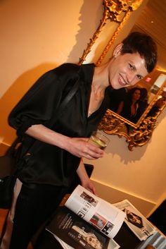 Model Saskia de Brauw raises a blass at the Edition Hotel opening in New York.