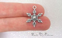 Hey, I found this really awesome Etsy listing at https://www.etsy.com/listing/113639687/6-snowflake-charms-tibetan-antique