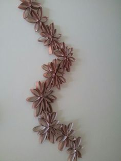 Wall art made from toilet paper rolls and sprayed copper