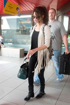 Selena Gomez in Berlin- I love this outfit, especially the backpack and hair. I would probably go with black jeans instead of leggings. But it's cool that they're the leggings from her Adidas Neo line.