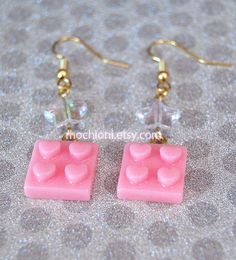 These earrings are made with cute pink lego cabochons, and iridescent star beads. You will be getting the pair that is pictured. Please feel free to