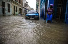 TOPSHOT - A Cuban stays in a flooded street in Havana, on September 10, 2017. Deadly Hurricane Irma battered central Cuba on Saturday, knocking down power lines, uprooting trees and ripping the roofs off homes as it headed towards Florida. Authorities said they had evacuated more than a million people as a precaution, including about 4,000 in the capital.  / AFP PHOTO / YAMIL LAGE        (Photo credit should read YAMIL LAGE/AFP/Getty Images) Photo: YAMIL LAGE/AFP/Getty Images