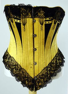 Corset    Date:      ca. 1880  Culture:      European  Medium:      silk  Dimensions:      Length at CF: 11 1/2 in. (29.2 cm)  Credit Line:      Isabel Shults Fund, 2001  Accession Number:      2001.373.1a, b