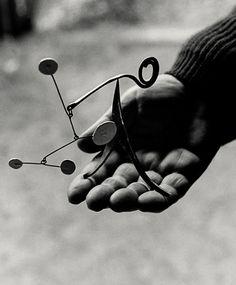 "scandinaviancollectors: "" ALEXANDER CALDER, Calder holding one of his miniature mobile sculptures, Saché, France 1963. Photograph by Ugo Mulas. / Palazzo Esposizioni """