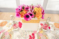 Light pink and yellow floral wedding table decor, photo by Mark Brooke Photographers