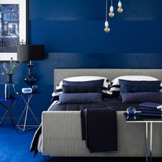 Industrial indigo bedroom  Be bold - drench your room in indigo blue. A saturated scheme requires some pluck, but the effect is so dramatic, it?s well worth taking the plunge.  Choose a deep shade of dark blue for the walls, then paint the skirting boards to match and go for a carpet in the same shade for an inky scheme that's ultra-chic.
