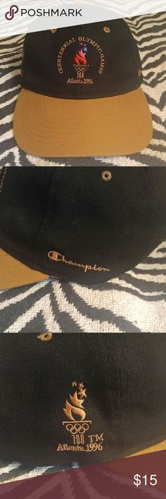 Vintage Champion Atlanta Olympics strapback hat Super rare vintage item made by Champion to commemorate the 1996 Olympic Games in Atlanta. Beautiful black hat with gold/tan logos including a Champion spellout logo on the side. Black leather strap with some wear (pictured) but I think it adds to the vintage feel of the hat. Other than that in nice shape! You won't find many of these, so get it while it's here! Champion Accessories Hats