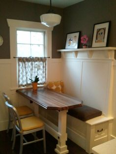 The kitchen nook my husband built. Picture taken before we added a custom bench cushion.
