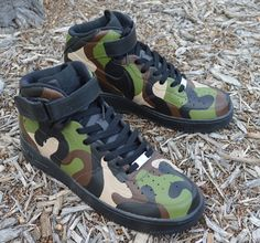 07db519d588 These Nike Air Force 1 Mids have a hand painted camo print all over. The