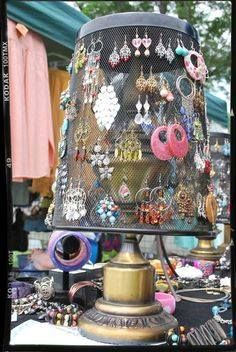 Upside metal trash can for jewelry display. Great idea! Can spray paint easily. Place on lazy Susan for easy viewing - Not sure I totally love this idea but I have to admit it's clever and a low-cost display idea.  I think it would be executed better.