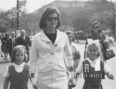 Jackie walking with Caroline and Sydney Lawford to school in NYC. Sydney is the daughter of JFK's sister Pat and Peter Lawford. She and Caroline were very close in age. When Pat and Peter learned of the assassination, they got on the next plane to DC and brought Sydney along for Caroline. She is also Jackie's goddaughter.