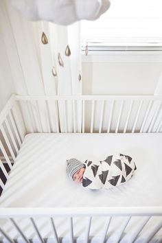 Adorable Baby Hudson under his Baby Jives Co gold raindrops mobile