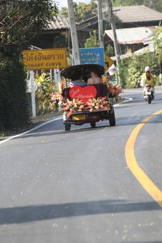 A Thai style wedding car, it was used in a wedding in Chiang Mai. The couple truly enjoyed the attention they got as they returned to the city center after their wedding night in the country side.    ThailandWeddings.com