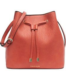 A relaxed silhouette mixes with luxe faux leather and gleaming hardware on the Gabrianna bucket bag from Calvin Klein. Large Crossbody Bags, Leather Crossbody, Designer Purses And Handbags, Small Sized Bags, Calvin Klein Handbags, Orange Bag, Burnt Orange, Stitching Leather, Online Bags