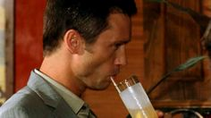 One of the rare times we see Michael take a swallow from a beverage. He normally just places it in his hands or makes the motions to raise it to his lips without touching the glass or the straw.   Pictured: Michael Westen (Jeffrey Donovan)