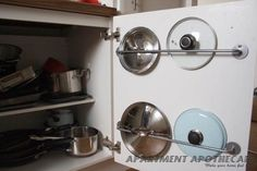 Ikea Bygel towel rail used to store pan lids