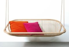 Hanging sofa. Haute the pillows, but this sofa on the patio, would Be nice
