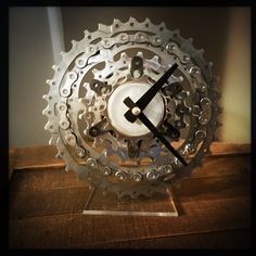 www.DreamGreatDreams.etsy.com this Bike Gear Desk Clock will make sure you're never late for a noontime ride again, and it's made entirely from recycled bicycle parts. eco friendly? yes please!