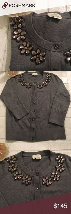Kate Spade Jeweled Embellished Cardigan in Grey Kate Spade Leni Embellished Cardigan In Grey. Bejeweled flowers frame the face around the neck and jeweled buttons. Material: Knit from soft Egypitan Cotton, Silk and Cashmere. In perfect condition! Retail $298.  No Trades. Price is firm unless bundled.  10% off 2 or more items or 20% off 3 or more items kate spade Sweaters Cardigans