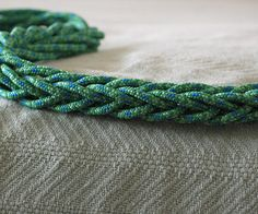 This pattern makes a really nice square braid.We will start out the same way as the first braid.2 Loops on the left hand - LMiddle and LRing.3 Loops o...