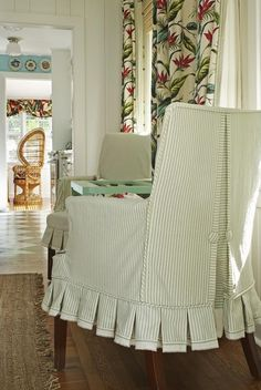 A pleated skirt adds a kicky cottage charm. She used the fabric's selvage as trim for the bottom of the skirts. Betsy Speert's FL Cottage.