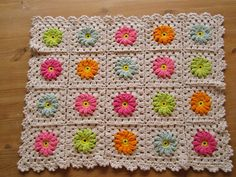 forum member made this into a pillow!  Color 'n Cream Crochet and Dream: Flower Square Tutorial III --