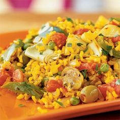Vegetarian Paella Recipe Main Dishes with extra-virgin olive oil, chopped onion, chopped green bell pepper, cremini mushrooms, garlic cloves, brown rice, fat free less sodium vegetable broth, water, saffron threads, dried thyme, tomatoes, green peas, pimento stuffed olives, flat leaf parsley, ground black pepper, artichoke hearts, flat leaf parsley