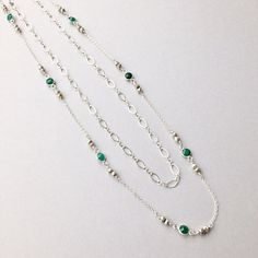 "Perfect Layering Essential; handmade at  46"", this beauty is composed of dainty emeralds, bright pyrite beads and an added accent chain. A delicate versatile piece for everyday. All metal components in sterling silver. ( $135) #emeraldjewelry #layeringnecklace #maybirthstone"