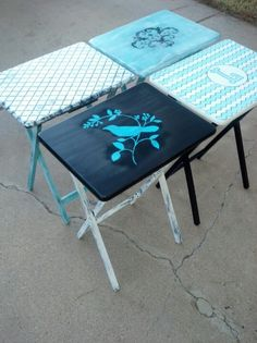 Custom refurbished tv trays...a couple of coats of paint, a couple of stencils, and a sander is all it takes...